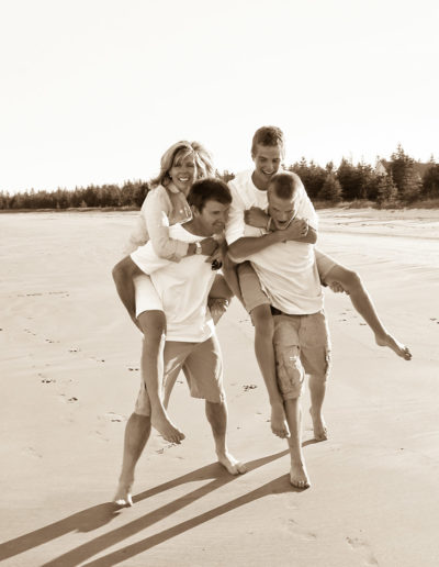 Bridget Havercroft Photography, Family, Bagnell Family, Spontaneous, Piggy Back Ride, Laughter, Fun, Beach, At the beach