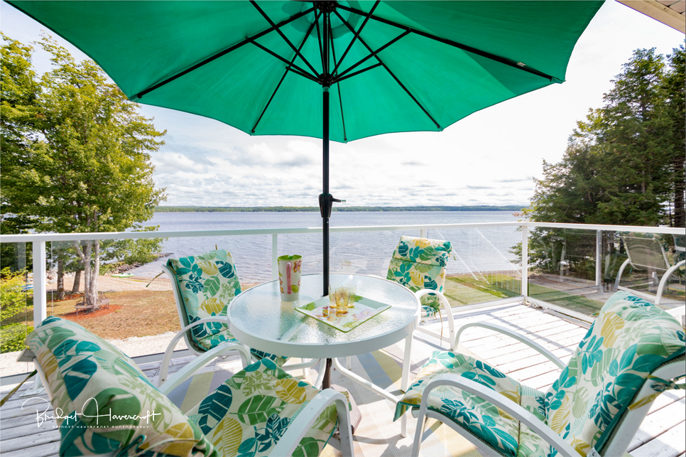 Outdoor deck with a view of Sherbrooke Lake