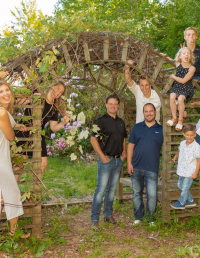 The extended members of the Hockley Family all surrounding a garden arbour